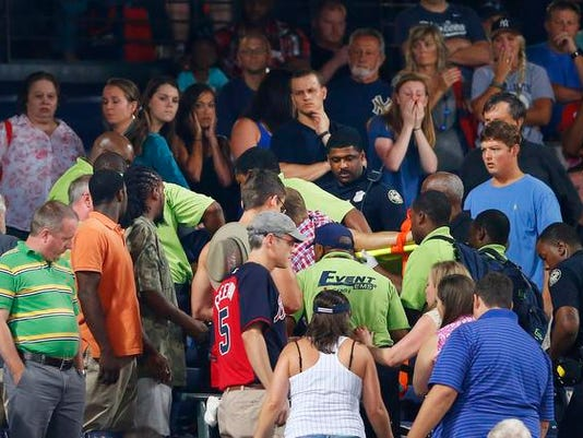 APTOPIX Turner Field Fan Falls Baseball