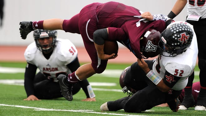 Anson defensive lineman David Galvan (52) tackles Abernathy running back Mark Pando (31) for a loss during the fourth quarter of Anson's 21-18 loss in the Class 2A Div. I state quarterfinal playoff on Saturday, Dec. 3, 2016, at Tiger Stadium in Snyder.