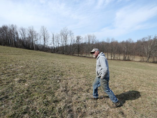 Chip Barrett walks in a field on his farm in Millerton on April 14, 2018.  Barrett has been exploring options to diversify businesses on his farm, and installing a solar array is one he would be interested in pursuing.