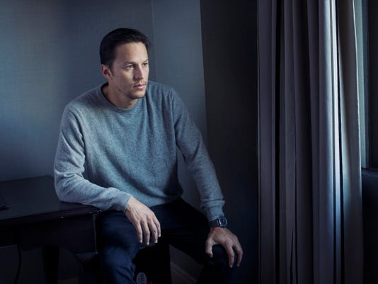 """In this Monday, Sept. 14, 2015 photo, director, Cary Fukunaga, poses for a portrait in promotion of his upcoming film """"Beasts of No Nation"""" at the 2015 Toronto International Film Festival in Toronto."""
