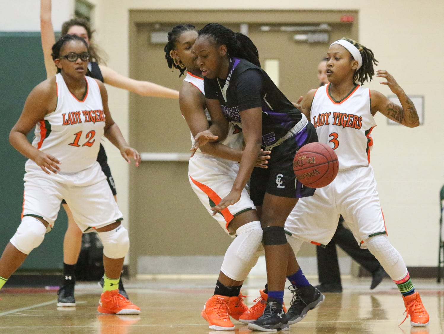 Dunbar's Keva'shay Edison (11) strips the ball from Cypress Lake's Shonteria Blanks (12) during the ladies basketball game at Dunbar High School in Fort Myers, FL on Wednesday, January 27, 2016. Dunbar defeated Cypress Lake to win the District 12 Championship.