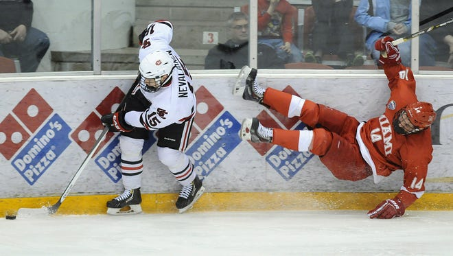 St. Cloud State's Niklas Nevalainen gets past Cody Murphy of Miami(Ohio) during a playoff game last season at the Herb Brooks National Hockey Center in St. Cloud.