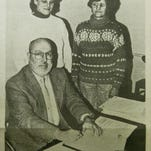 Dell Rapids Mayor Tom Earley signs a proclamation in 1991, declaring Jan. 27 to Feb. 2 Catholic Schools Week in Dell Rapids. St. Mary is prepresented by Wanda Tommeraasen, left, and Marie Roemen, right.