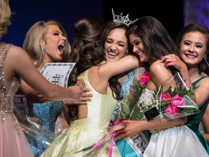 Miss Jackson's Outstanding Teen Mary Humphrey is embraced