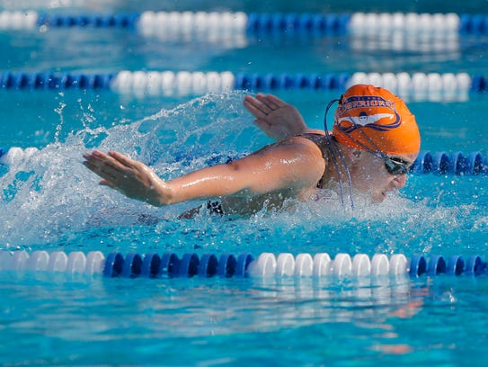 Westlake High's Sarah Clarke swims to first in the