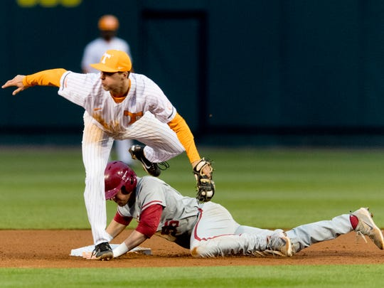 Tennessee infielder Andre Lipcius (13) tries to tag Alabama's designated hitter Matt Malkin (55) at second during a game between Tennessee and Alabama at Lindsey-Nelson Stadium in Knoxville, Tennessee on Friday, March 23, 2018.