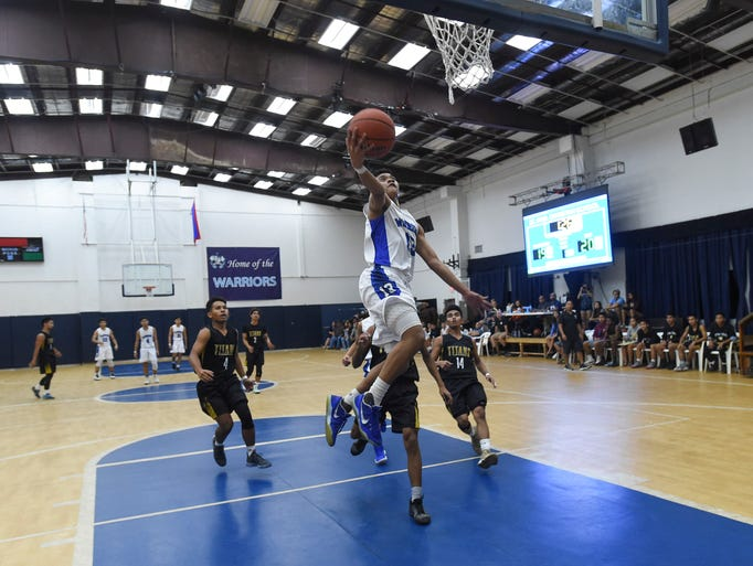 St. Paul's Jahmar White (13) glides to the basket for