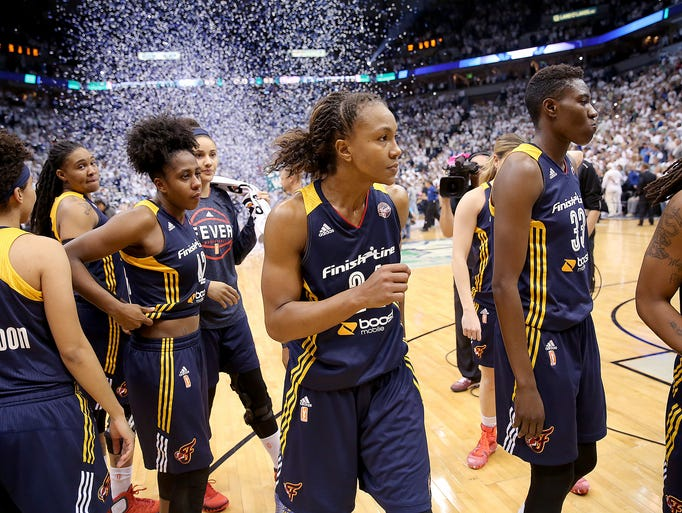 Indiana Fever forward Tamika Catchings (24),middle,