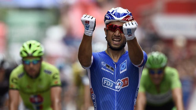 "FDJ.fr's French cyclist Nacer Bouhanni celebrates as he crosses the finish line to win the 8th stage of the 69th edition of ""La Vuelta"" Tour of Spain, a 207 km ride from Baeza to Albacete on Saturday."