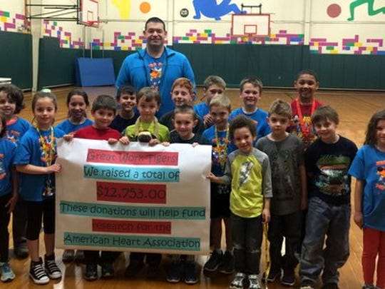 "Students at Three Bridges School in Readington collected $12,753 in donations during their February ""Jump Rope for Heart"" fundraiser.  Each year the elementary school raises money to help fund research by the American Heart Association.  The highest earning students pictured  with teacher Ed Dubroski include Charlie Ball, Ferris Bowser, Blake Conroy, Jack Edwards, Chris Engelhardt, Yesim Gokmen, Jeremy Hughes, Christian Manetta, Demetrius Preston, Tucker Rhoades, Steven Ritter, Arriana Sanchez, Connor Stevens, Amy St. Miklosy, Sofia Trabilcy, Aiden Zalewski, and Thomas Zenz."