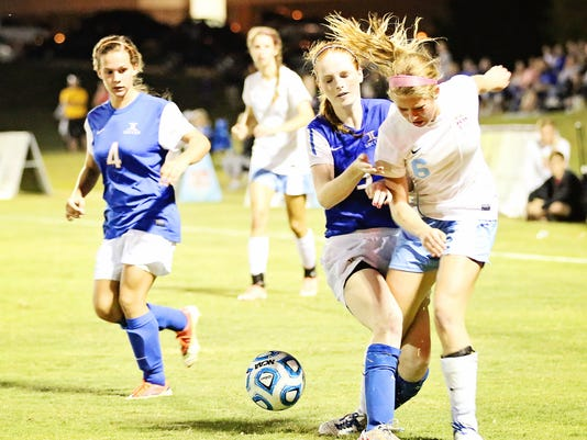 1 Addison Dunn, #6 USJ gets tangled up with JC defender #3 Alicia Maners on .JPG