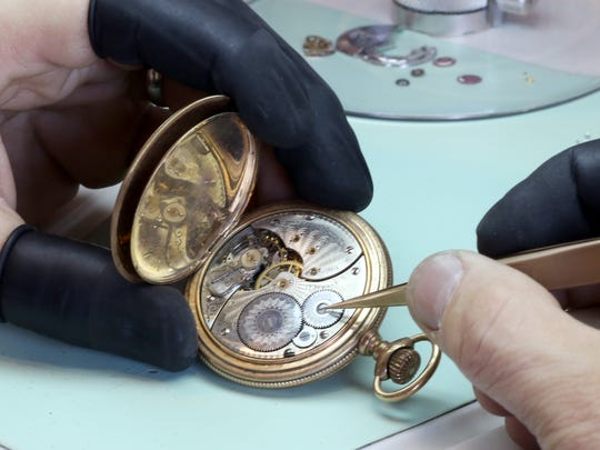 Jeff Forslung examines a century-old Rockford Watch Company pocket watch, one of an estimated one million made between 1873 and 1915 in Rockford, IL, for cleaning and restoration at Lake Country Jewelers in Pewaukee.