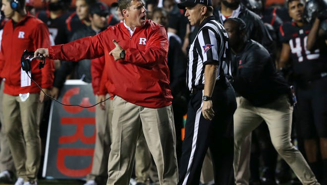 Rutgers head coach Chris Ash, front left, complains about a call to field judge John Roggeman during the first half of an NCAA college football game against Michigan, Saturday, Oct. 8, 2016, in Piscataway, N.J. (AP Photo/Mel Evans)