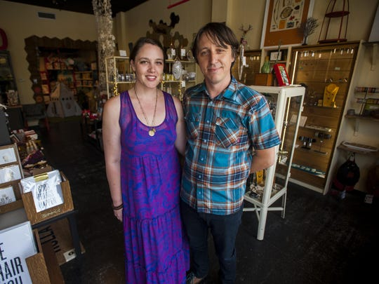 Jillian Johnson is pictured in July 2014 in Red Arrow Workshop with her husband, Jason Brown. Johnson was killed in a shooting at the Grand Theater Thursday night.