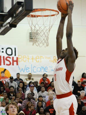 North Caddo's Chris Thomas skies for a dunk in a 69-47 quarterfinal win over Episcopal last season.