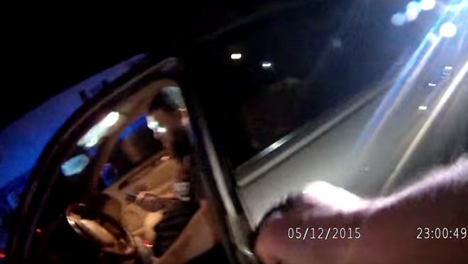 This screenshot shows 28-year-old Derek Twyman in his car during a May 2015 police stop in Gettysburg as Gettysburg Borough Police Officer Christopher Folster aims his Taser at him.