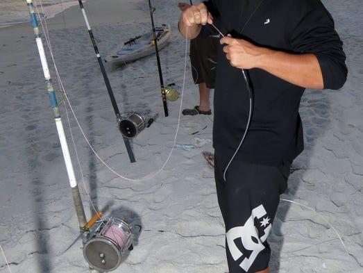Land based angler reels in another massive shark for Shark fishing rod