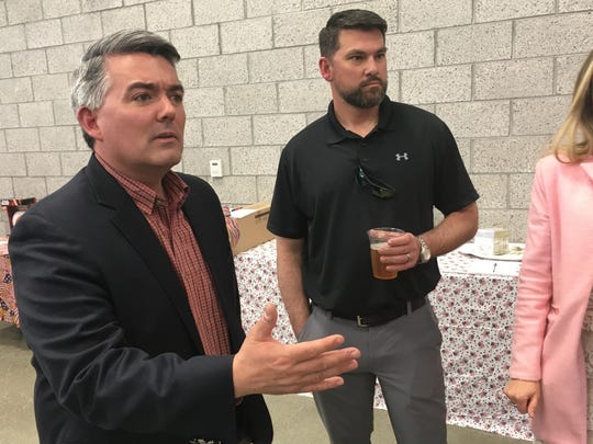 Sen. Cory Gardner, R-Colo., attends the Alamosa County Republicans Lincoln Day dinner in Alamosa, Colo., on April 24, 2019. Republicans are warning that Democratic proposals aimed at providing universal health care and curbing greenhouse gas emissions show that Democrats want to turn the U.S. toward socialism. Among those making that pitch Gardner, who faces re-election next year.
