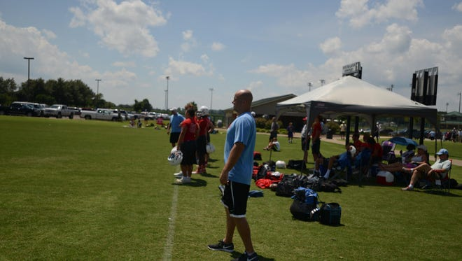 Donnie Nickey helps coach USJ's football team at a 7-on-7 camp in Martin last summer.