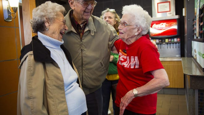 In a Friday, March 24, 2017 photo, Loraine Maurer is congratulated by customers at the N. Green River McDonald's location in Evansville, Ind. A celebration was held Thursday for Maurer for more than four decades of work at local McDonald's restaurants. Many seniors are working well past retirement age.