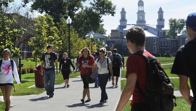 Students stroll the University of South Dakota campus in 2011.