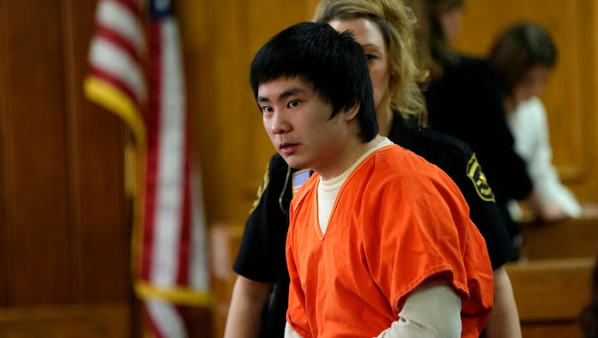 Dylan Yang, 16, exits the courtroom during a break in his sentencing hearing at the Marathon County Courthouse, October 19, 2016.