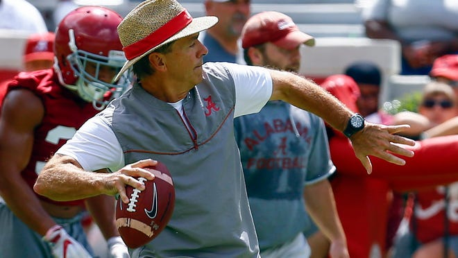 Alabama head coach Nick Saban throws a pass during a NCAA college football practice, Saturday, Aug. 4, 2018, in Tuscaloosa, Ala. (AP Photo/Butch Dill)
