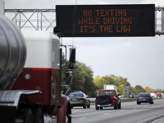 Indiana Department of Transportation dynamic message signs spread the word in 2011 that Indiana's texting and driving law had gone into effect. By law, all drivers are banned from text messaging and driving. Drivers younger than 18 are banned from texting and talking on cellphones.
