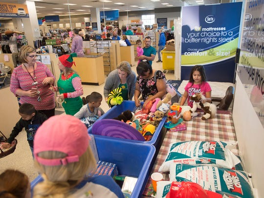 Kids pick out a free toy at Goodwill in Fort Collins on Saturday, December 9, 2017. A group of donors purchased all toys, including games and stuffed animals, in the store to allow kids to take a toy home for Christmas.