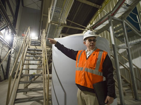 David Hagerman, regional vice president with Martin Marietta, shows the features of a Ready-Mix facility at the company's new concrete and asphalt distribution center near Johnstown.
