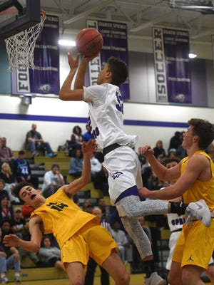 Spanish Springs' Jalen Townsell (32) goes to the basket over Bishop Manogue's Kolton Frugoli (10) during their basketball game at Spanish Springs on Dec. 22.