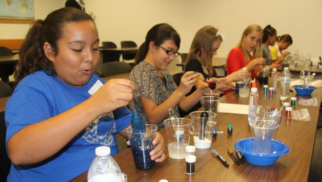 Charlize Lopez was surprised as she mixed Borax and glue together at the Expanding Your Horizons Conference on Friday.