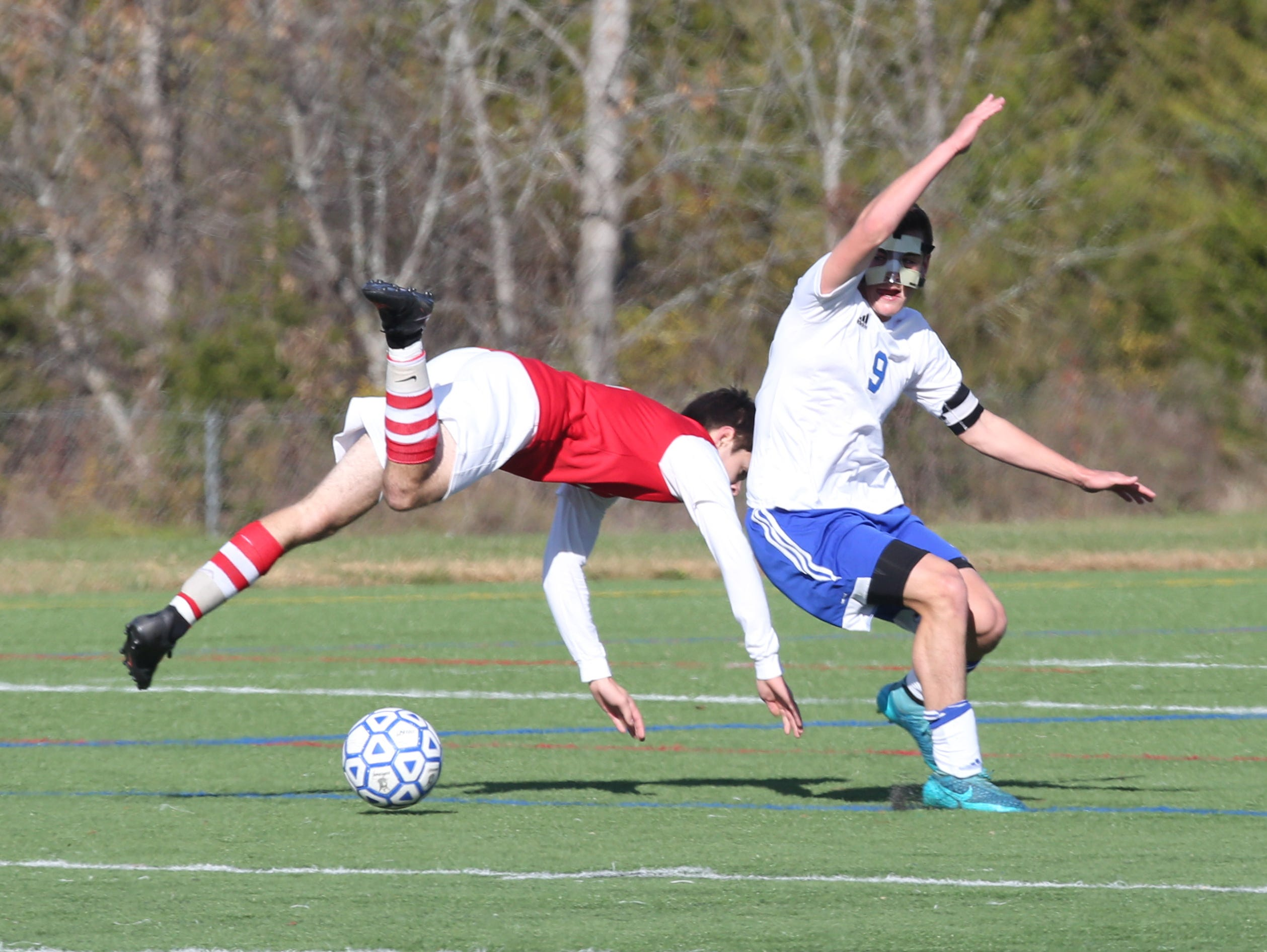 Tappan Zee's Graham Skywark goes flying behind Pearl River's Mark Russel during action in the Section One Class A boys final at Arlington High School, Oct. 31, 2015.