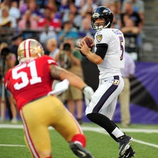 Aug 7, 2014; Baltimore, MD, USA; Baltimore Ravens quarterback Joe Flacco (5) throws a pass over San Francisco 49ers linebacker Dan Skuta (51) in the first quarter at M&T Bank Stadium. Mandatory Credit: Evan Habeeb-USA TODAY Sports