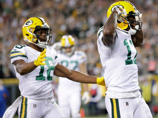Green Bay Packers wide receiver Davante Adams (17) reacts after scoring a touchdown on a five-yard reception during the first quarter of their game against the Chicago Bears Thursday, September 28, 2017 at Lambeau Field in Green Bay, Wis.