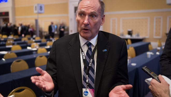 Jim Delany, Big Ten Commissioner,  speaks with reporters at the NCAA's Autonomy Business Session during the final day of the NCAA Convention in Oxon Hill, Md., Saturday, Jan. 17, 2015. The five most powerful and wealthiest conferences in college sports passed NCAA legislation that increases the value of an athletic scholarship by several thousand dollars to cover the federally determined actual cost of attendance. (AP Photo/Cliff Owen)