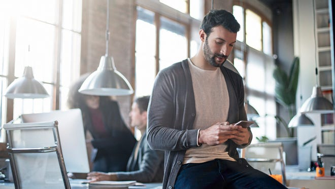 """Spending too much time on your mobile phone can lead to poor posture and symptoms of """"text neck,"""" occurringwhen the head is titled in a forward or downward position while the shoulders are drooped."""