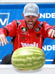 LONG POND, PENNSYLVANIA - JULY 27: Ross Chastain, driver of the #45 Niece/Acurlite Chevrolet, celebrates by smashing a watermelon in Victory Lane after winning the NASCAR Gander Outdoors Truck Series Gander RV 150 at Pocono Raceway on July 27, 2019 in Long Pond, Pennsylvania. (Photo by Sean Gardner/Getty Images) ORG XMIT: 775380092 ORIG FILE ID: 1164584063
