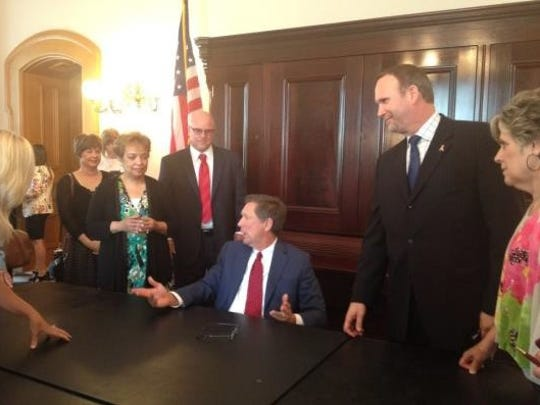 David Carr (far right) and several advocates from the Leukemia and Lymphoma Society visited Gov. John Kasich's office for the signing of SB 99.