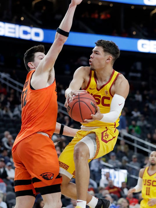 Oregon State's Drew Eubanks, left, defends against Southern California's Jordan Usher during the first half of an NCAA college basketball game in the quarterfinals of the Pac-12 men's tournament Thursday, March 8, 2018, in Las Vegas. (AP Photo/Isaac Brekken)
