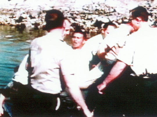 "FILE - In this file photo from the late 1960s provided by the Northwest Indian Fisheries Commission, Billy Frank, center, is arrested during a ""fish-in"" staged near the Washington State Capitol in Olympia, Wash. Frank, a Nisqually tribal elder who was arrested dozens of times while trying to assert his native fishing rights during the Fish Wars of the 1960s and '70s, died Monday, May 5, 2014. He was 83."
