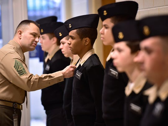 Master Sgt. Louis Montney conducts inspections of JROTC Naval cadets at CASHS, Friday, Jan. 22, 2016.