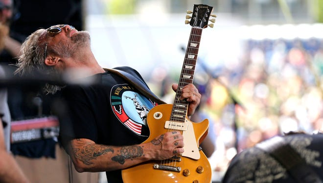 Anders Osborne performs at the New Orleans Jazz and Heritage Festival in New Orleans, Saturday, April 23, 2016.