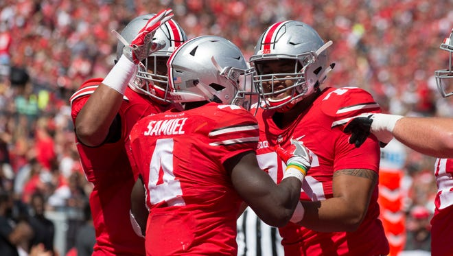 Ohio State running back Curtis Samuel (4) celebrates with teammates after his touchdown in the second quarter of the Buckeyes' 77-10 win against Bowling Green on Saturday.