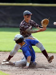 South River vs. Pennsville in NJSIAA Group I baseball semifinal on Tuesday June 7, 2016 held at Rowan University in Glassboro.South River's # 24 Brandon Szerszen (top) waits for the ball as Pennsville's # 5 Ed Camp slides into 2nd base.