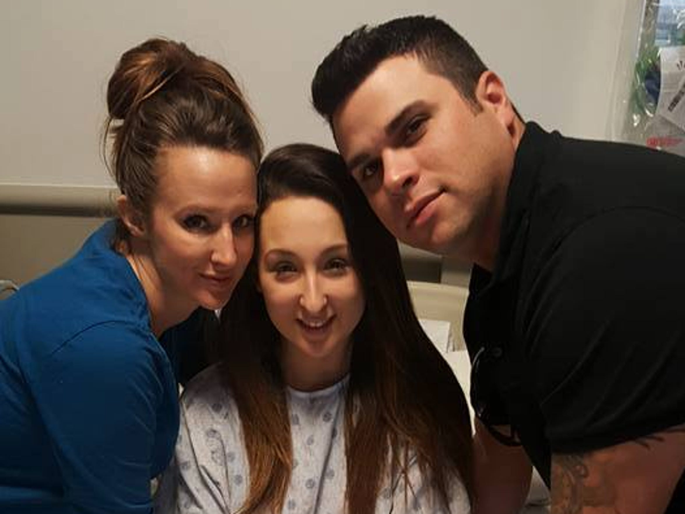 Alexis and her parents, Christina and Derek, prior to surgery last week.