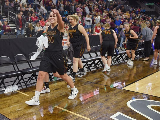 Harrisburg's Jeniah Ugofsky points to her classmates