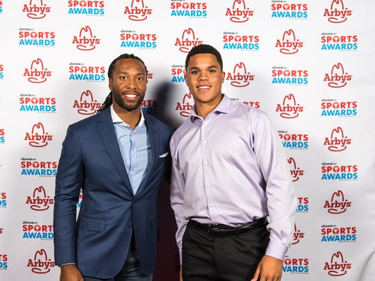 Larry Fitzgerald poses for a photo with Turner Washington
