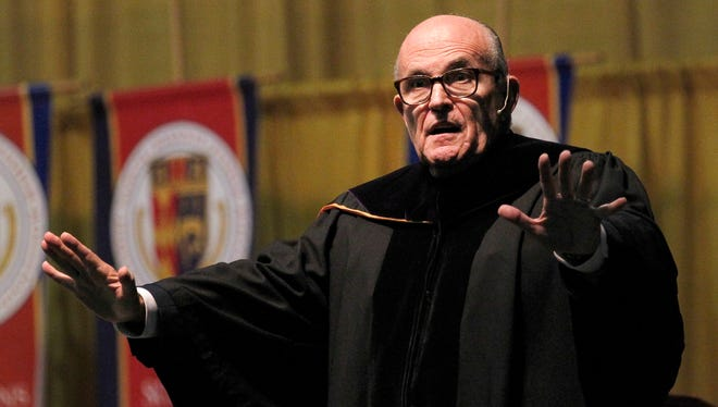Citing such leaders as Abraham Lincoln, Franklin Roosevelt and Ronald Reagan, former New York City Mayor Rudolph Giuliani says that leaders need to have strong beliefs. He delivered the commencement speech to the 2015 graduating class from St. John FIsher College at the Blue Cross Arena on May 9.