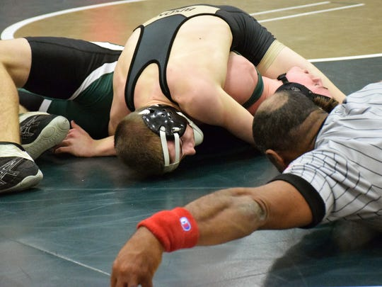 Buffalo Gap's Cullen Bendel, top, picks up back points against Wilson Memorial's Michael Deegan during their 132-pound bout at the Shenandoah District duals on Thursday, Jan. 19, 2017, at Wilson Memorial High School in Fishersville, Va. Bendel won by pin.